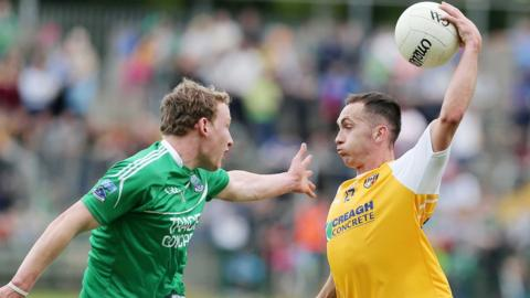 Fermanagh defender Aidan Breen closes in on Brian Neeson, who impressed with 1-6 for the Saffrons