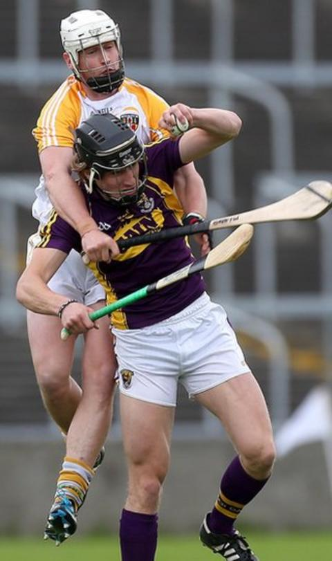 Antrim's Aaron Graffin gets a firm grip on Liam Og McGovern in the Leinster SHC quarter-final against Wexford in Portlaoise