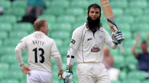 Worcestershire centurion Moeen Ali raises his bat at The Oval