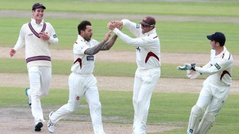 Peter Trego (second left) celebrates with his Somerset team-mates at Old Trafford