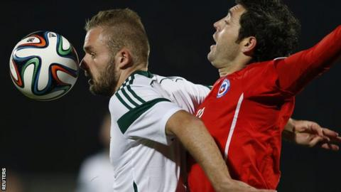 Northern Ireland's Ryan McLaughlin attempts to hold off Jose Rojas of Chile