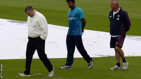 Umpires inspect the pitch at Wantage Road