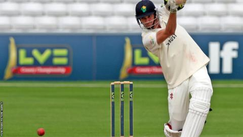 Glamorgan's Michael Hogan hits a boundary on the final day of the County Championship match against Essex in Chelmsford.