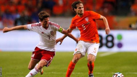 Wales captain Joe Allen battles for the ball with Daley Blind of Netherlands during the friendly match at the Amsterdam Arena on Wednesday.