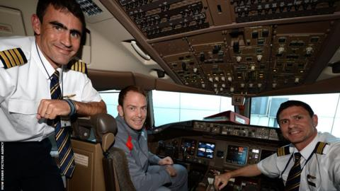 Wales captain Alun Wyn Jones sits at the controls of the team's plane before it takes off for the tour to South Africa.