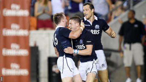 Scotland's Stuart Hogg (left) celebrates his try with team-mates Finn Russell (centre) and Tim Visser