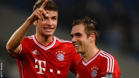 Bayern Munich's Thomas Muller and Philipp Lahm