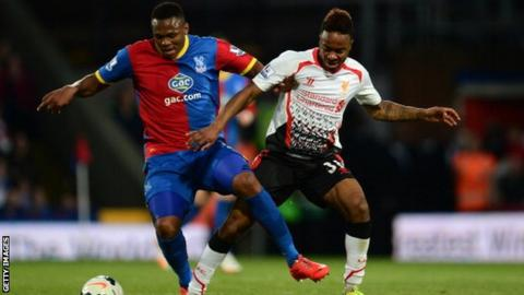 Kagisho Dikgacoi in action for Crystal Palace battling for the ball with Liverpool's Raheem Sterling.