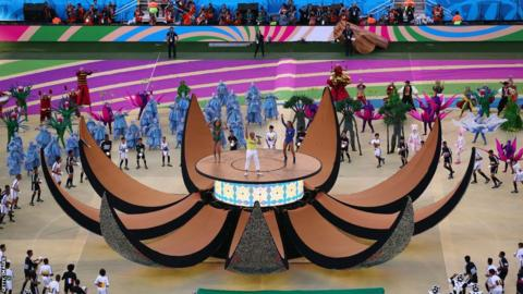 The central ball opened up to reveal singers Jennifer Lopez and Claudia Leitte and rapper Pitbull as the finale to the opening ceremony