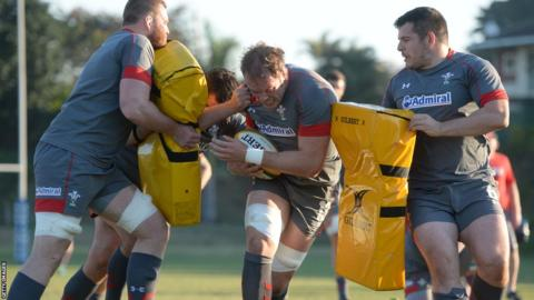 Wales captain Alun Wyn Jones drives through crash pads during a Welsh training session in South Africa.