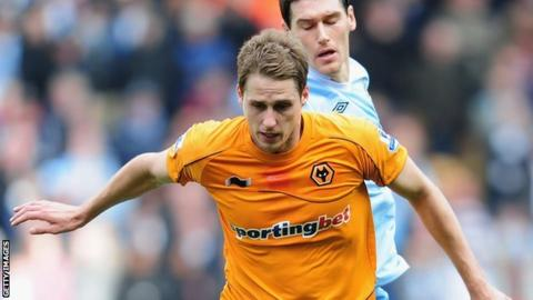 Wolves' Dave Edwards fends off Manchester City's Gareth Barry