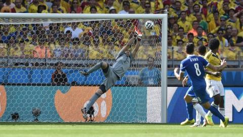 Greece's Panagiotis Kone forces a save from Colombian goalkeeper David Ospina