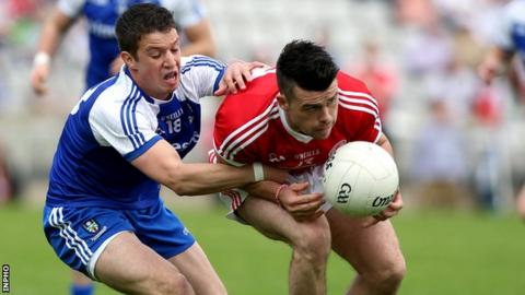 Gerard McCaffrey of Monaghan in action against Darren McCurry of Tyrone