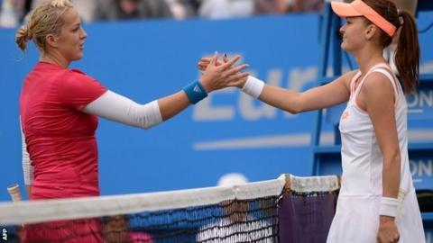 Anastasia Pavlyuchenkova shakes hands with Agnieszka Radwanska after winning their women's singles first round match at Eastbourne