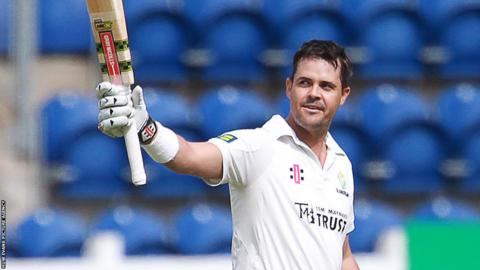 Jacques Rudolph of Glamorgan celebrates scoring a century against Kent on day two of their County Championship match in Cardiff.