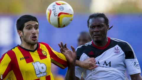 Gabriel Piccolo and Calvin Zola battle for possession during a match between Partick Thistle and Aberdeen