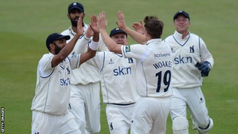 Warwickshire's players celebrate the fall of another Northants wicket at Wantage Road