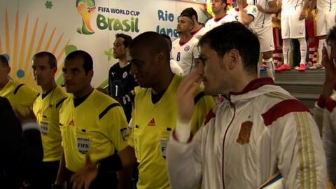 Spain's Iker Casillas watches an assistant referee be passed over for a handshake