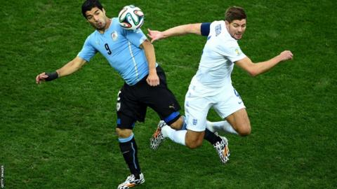 Uruguay's Luis Suarez (left) in action against England captain Steven Gerrard