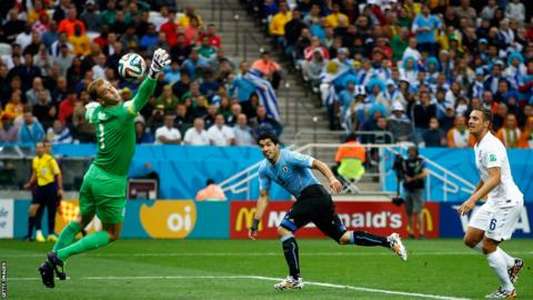 Luis Suarez beats England goalkeeper Joe Hart with a header to put heads Uruguay ahead