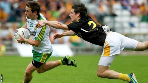 Darach O'Connor bursts past Antrim's Kevin O'Boyle at Clones