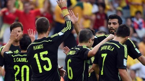 Spain beat Australia 3-0 in Group B