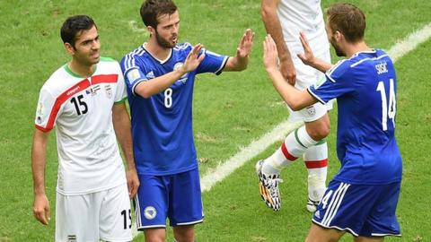 Bosnia's Miralem Pjanic celebrates scoring with team-mate Tino Sven Susic