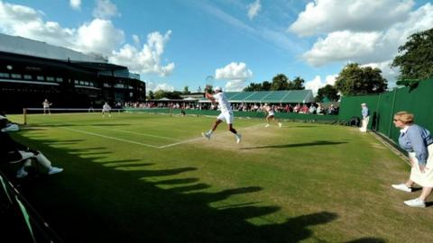 Players in action at Wimbledon 2014