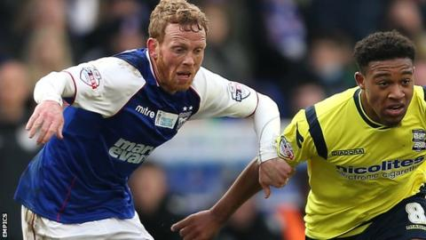 Paul Green (left) playing against Birmingham