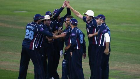 Northants players celebrate the dismissal of Shoaib Malik
