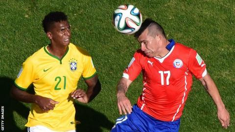 Gary Medel heads the ball during Chile's World Cup match against Brazil