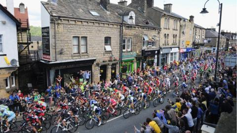 The Tour de France peloton rides through the centre of Ilkley