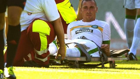 Scott Brown is carried off during his side's friendly against Rapid Vienna