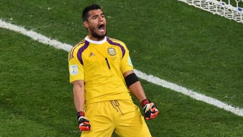 Argentina's goalkeeper Sergio Romero reacts after saving a penalty