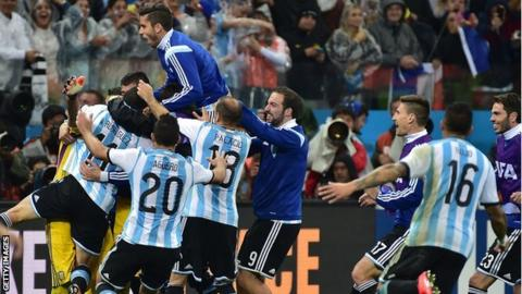 Argentina players celebrate their penalty shootout victory over the Netherlands in the 2014 Fifa World Cup semi-final in Sao Paulo