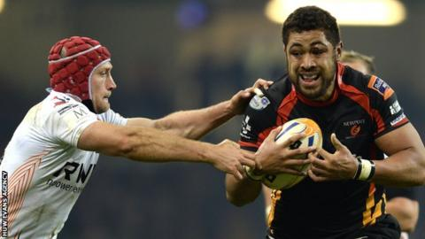 Ospreys' Richard Fussell tries to tackle Newport Gwent Dragon Taulupe Faletau