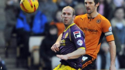 Wolverhampton Wanderers's Sam Ricketts (right) and Gareth Roberts Notts County's (left) challenge