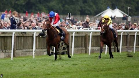 Integral, ridden by Ryan Moore, wins the Qipco Falmouth Stakes