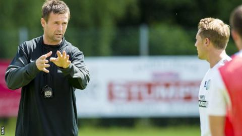Celtic manager Ronny Deila talks to some of his players during training