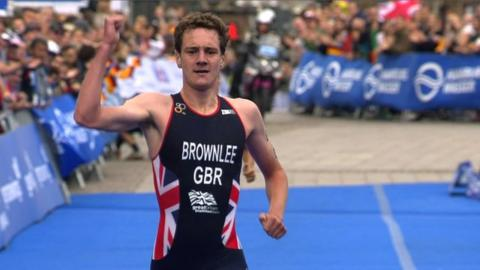 Alistair Brownlee sprints to the line as Great Britain's triathletes win gold at the Mixed Relay World Championships in Hamburg