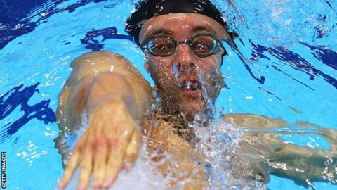 Marco Loughran during a backstroke race