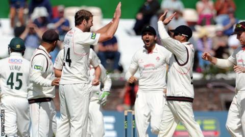 Tom Smith celebrates a wicket