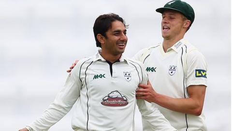 Saeed Ajmal (left)