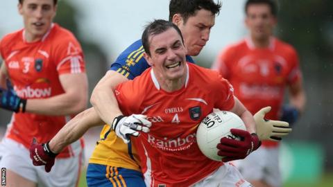 Roscommon's David O'Gara challenges Armagh's Andy Mallon at Dr Hyde Park