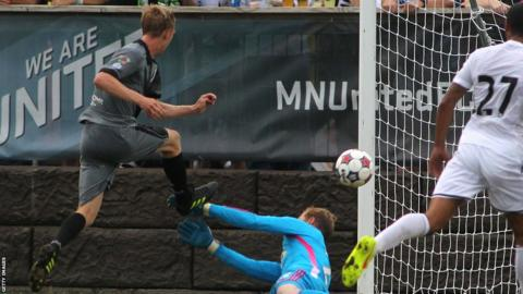 Minnesota United's Greg Jordan fires a shot past Swansea City goalkeeper Gerhard Tremmel to give his side a 2-0 lead in their pre-season friendly