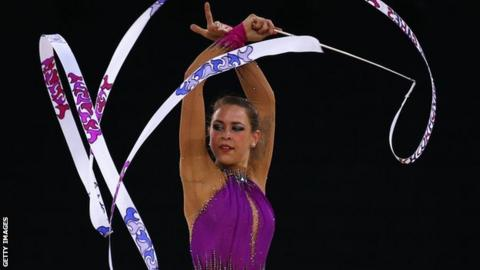 Francesca Jones of Wales competes in the ribbon section in Glasgow