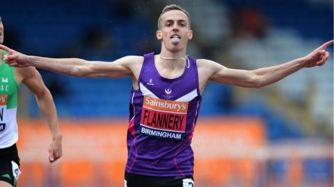 Niall Flannery celebrates as he crosses the line to become 2014 British 400m hurdles Champion