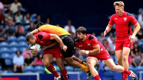 Wales rugby sevens team kicked off their Commonwealth Games campaign with a comprehensive 52-0 victory over Malaysia at Ibrox.