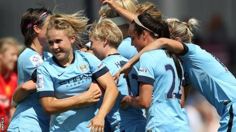 Manchester City Women's celebrate their goal against Liverpool