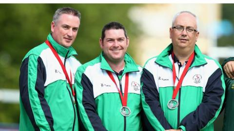 Paul Daly, Neil Mulholland and Neil Booth secured a silver medal for Northern Ireland in the men's triples bowls